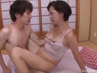 Busty Japanese MILF with glasses pounded doggy increased by missionary