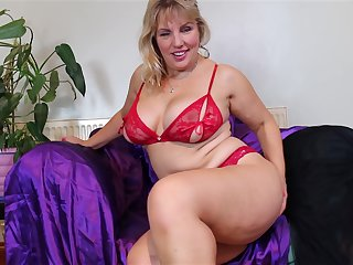 Mature playful blonde MILF Danielle strips and plays with herself