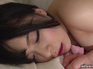 Luscious Asian babe Satomi Nagase is finger bonking shaved pussy