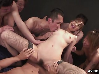Japanese cutie in fishnets rides a unearth for an audience
