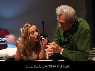 Young girl teaches old man kissing and shafting