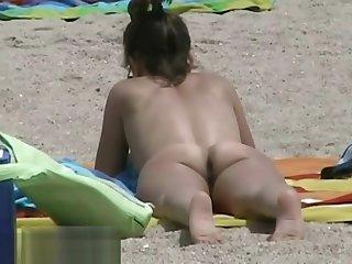 Hidden beach camera video of lovable nudist