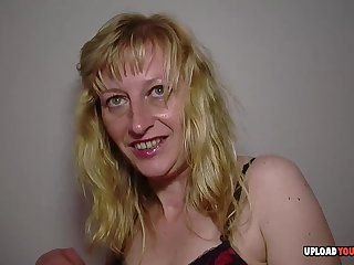 Kinky blonde sucks on her own tits before she penetrates her juicy slit.